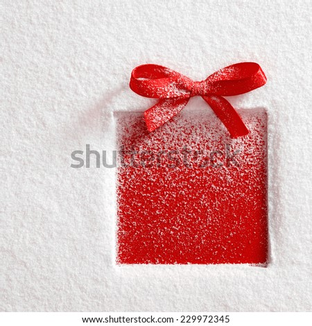 gift with a bow on snow background - stock photo