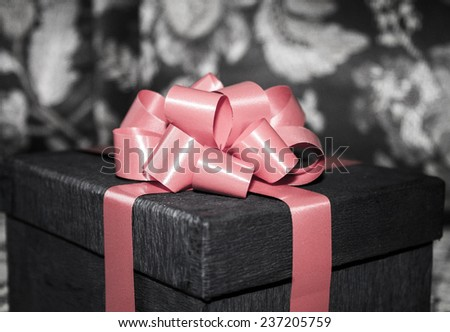 gift with a red bow. - stock photo
