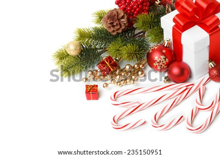 Gift with christmas tree and candy isolated on white background - stock photo