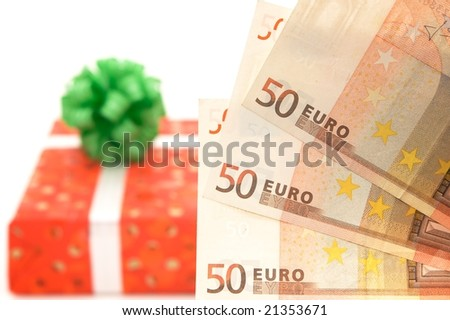 Gift with money isolated on white - stock photo