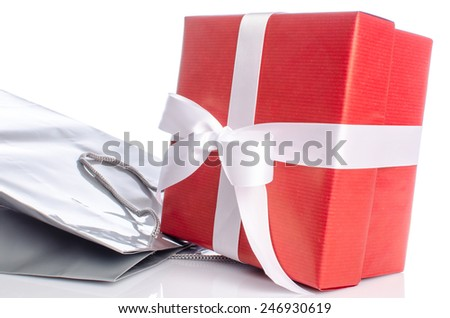 Gift with paper shopping bag, isolated on white