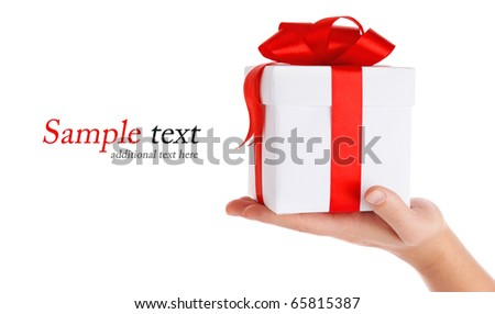 gift with red bow in hand isolated on white background - stock photo