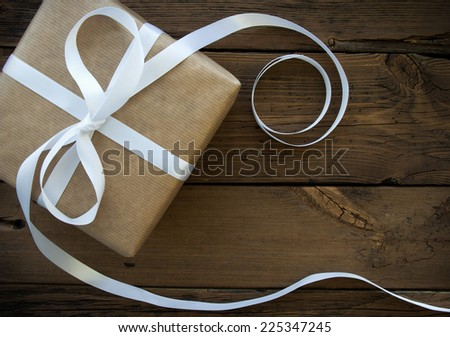Gift With White Ribbon With Frame - stock photo
