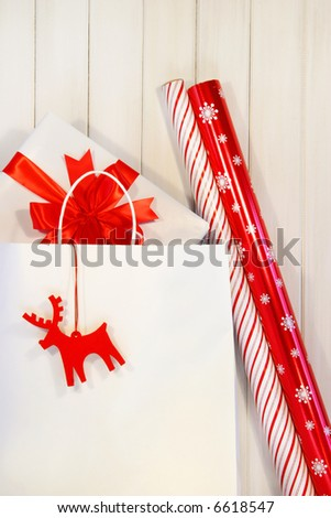Gift with white shopping bag and wrapping paper - stock photo