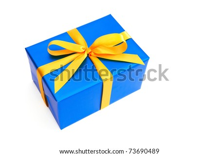 Gift with yellow ribbon isolated on white - stock photo