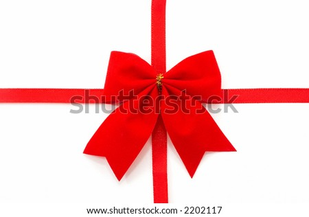 Gift wrap on a white background, top view, horizontal orientation, central bow. - stock photo