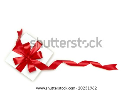 gift wrapped with a red ribbon on a white background - stock photo