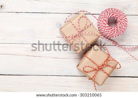 Gift wrapping over white wooden table with copy space - stock photo