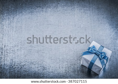 Giftbox blue bow on metallic background greeting card holidays concept. - stock photo