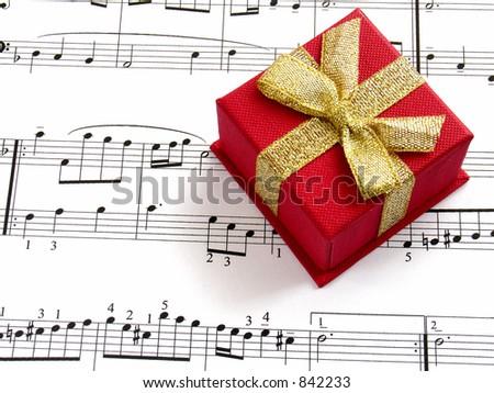 giftbox on music sheet - stock photo