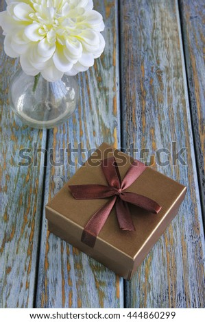 Giftboxe on vintage wooden board