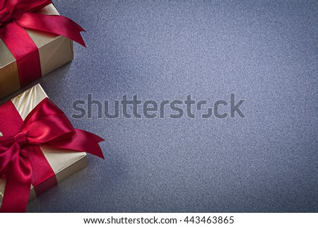 Giftboxes with red bows on grey background copy space holidays concept. - stock photo