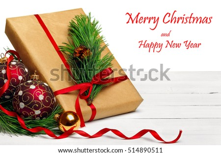 gifts and balls on red background.Christmas greeting card.white background