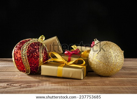 gifts and new-year decorations on a black background