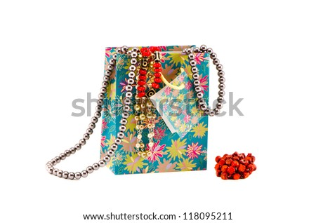 gifts bag with assorted necklaces isolated on white - stock photo