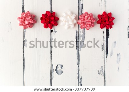 gifts bows in a row, festive background - stock photo