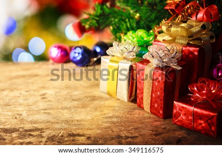 gifts decoration with christmas tree on wood - stock photo