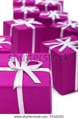 Gifts in magenta paper isolated on white background - stock photo