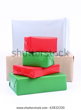 Gifts in small and big boxes in silver, brown, green and red wrapping  on white background