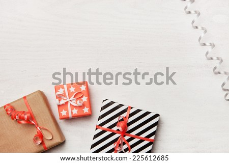 Gifts on white wooden background. Christmas background. - stock photo