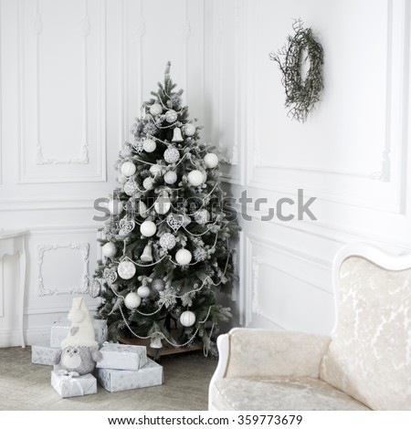 Gifts under the Christmas tree. Christmas background. Christmas tree decorated in white - stock photo