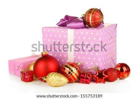 Gifts with christmas balls, isolated on white - stock photo