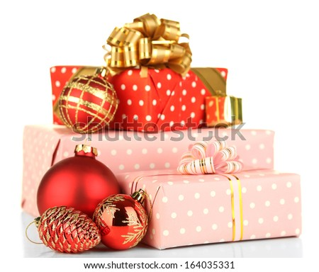 Gifts with christmas decorations, isolated on white - stock photo
