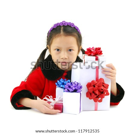 gifts with little girl in Santa claus clothes isolated on white - stock photo