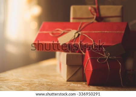Gifts wrapped in red and brown ecological paper - stock photo