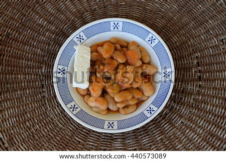 Gigantes giant beans with carrots and feta cheese. Greek food. - stock photo