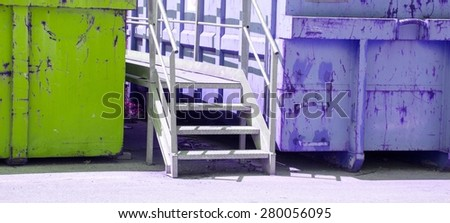gigantic colored containers of toxic waste landfill - stock photo