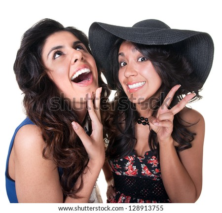 Giggling female friends on isolated background - stock photo