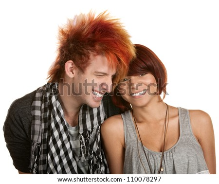 Giggling young teenage couple over white background