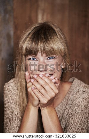 Giggling young woman in studio