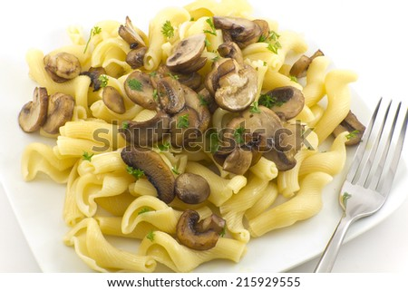 Gigli Con Funghi pasta dish with chopped parsley leaves - stock photo