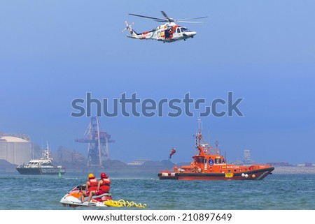 GIJON-SPAIN - JULY 27: AgustaWestland AW139 during rescue exhibition in IX AIR FESTIVAL on july 27, 2014 in Gijon,Spain. - stock photo