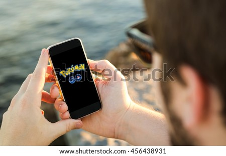GIJON, SPAIN - July 18, 2016: Pokemon Go logo on the phone. Pokemon Go is a location-based augmented reality mobile game.