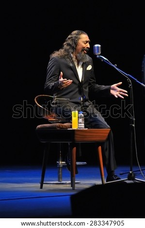 """GIJON, SPAIN - MAY 30: Legendary flamenco singer Diego el Cigala performs at the Theatre La Laboral in May 30, 2015 in Gijon, Spain. Intimate live show to launch his new record """"Vuelve el flamenco""""  - stock photo"""