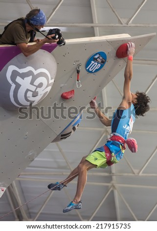 "GIJON, SPAIN Sep 13 2014:  "" The Japanese climber Sachi Amma, who won the bronze medal in the IFSC World Climbing Gijon 2014""  held in the spanish city of Gijon, from 8 to 14 September, 2014 - stock photo"