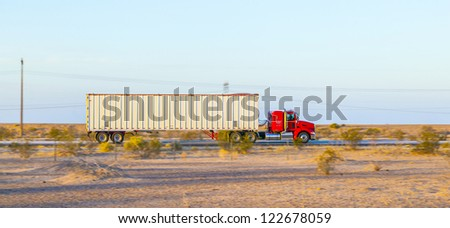 GILA BEND, USA - JULY 11: truck on interstate 8 in early morning at July 11, 2012 in Gila Bend, USA. I-8 was part of the original 1957 plan of Interstates, following US 80 from San Diego to Gila Bend. - stock photo