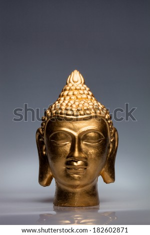gilded Buddha head - stock photo