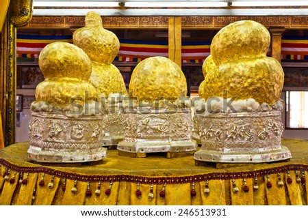Gilded Buddha statues at Phaung Daw Oo pagoda in Inle Lake, Shan State, Myanmar. The images have been covered in gold leaf by Buddhist devotees to the point that their original forms cannot be seen. - stock photo
