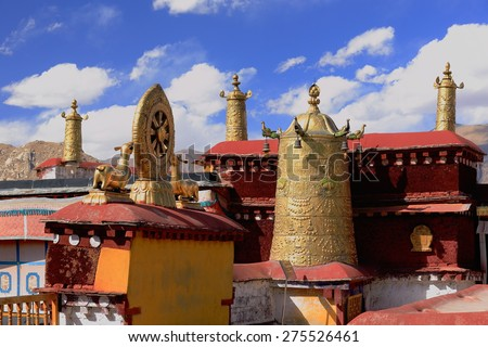 Gilded dhvajas-victory banners and dharmachakra-wheel of dharma-wheel of law with deers on the rooftop of  the AD.642 founded-25000 m2 Jokhang-House of Buddha temple. Lhasa-Tibet. - stock photo
