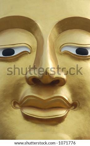 Gilded face of Buddha at Buddha Hill in Pattaya, Thailand - stock photo