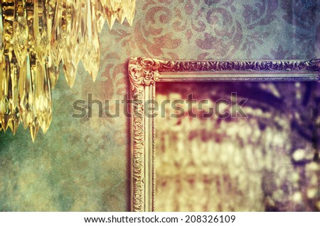 Gilded mirror reflection of chandelier  - stock photo