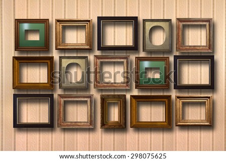 Gilded wooden frames for pictures on striped background  - stock photo