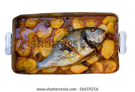 gilthead bream fish roasted in a tray