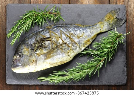 gilthead seabream ready to cook - stock photo