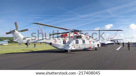 GILZE-RIJEN, NETHERLANDS - JUNE 21, 2014: Belgian NH90 military helicopter at the Dutch Air Force open days 2014. The airbase was in 2 days visited by 245,000 visitors. - stock photo