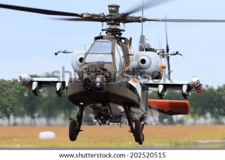 GILZE-RIJEN, NETHERLANDS - JUNE 20: Special painted Dutch Air Force AH-64 Apache about to land at the Royal Netherlands Air Force Days June 20, 2014 in Gilze-Rijen, Netherlands.  - stock photo